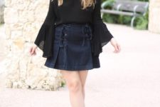 With mini skirt and gray cutout boots