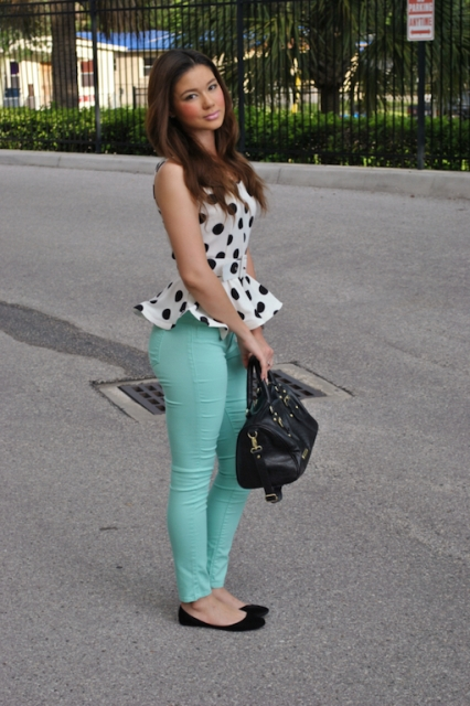 With mint green pants, black bag and black flat shoes