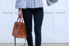With navy blue jeans, brown bag and platform sandals