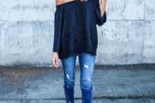 With navy blue off the shoulder top and distressed jeans