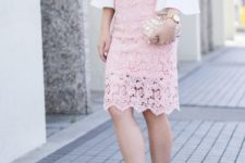 With pale pink lace knee-length skirt, embellished clutch and white pumps