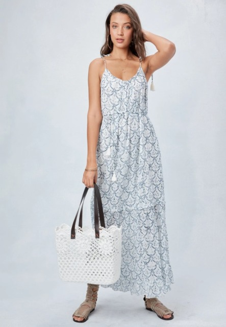 With pastel colored printed sleeveless maxi dress and gray lace up flat sandals