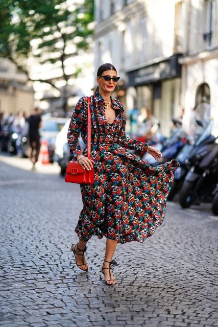 With printed long sleeved dress and red leather bag