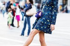 With printed mini dress and colorful bag