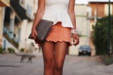 With printed mini skirt, gray clutch and golden sandals