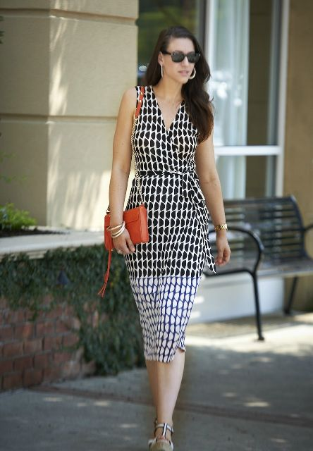 With red chain strap bag, sunglasses and platform shoes