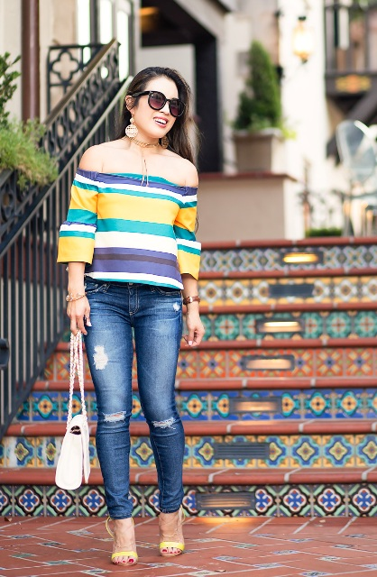 With skinny jeans, white bag and yellow high heels