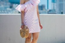 With straw bag and brown platform sandals