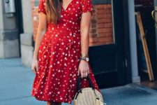 With straw bag and white mules