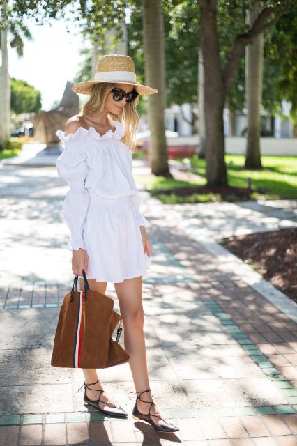 With straw hat, brown tote bag and lace up flat shoes