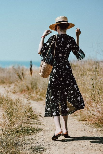 With straw hat, straw tote bag and black flat mules
