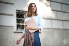 With striped button down shirt and denim skirt