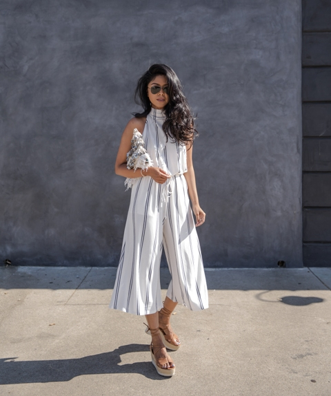 With striped culotte jumpsuit and clutch