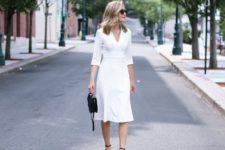 With white V-neck midi dress and black mini bag