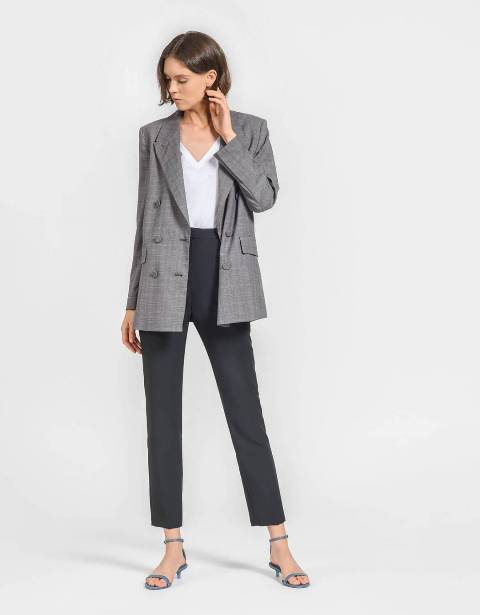 With white V-neck shirt, gray trousers and gray printed blazer