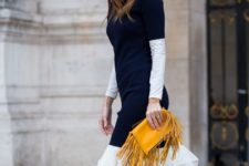 With white and black knee-length dress and white lace up shoes