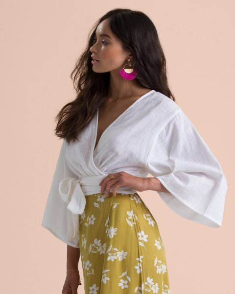 With white and yellow floral skirt