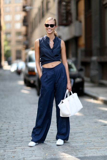 With white bag, navy blue wide leg trousers and white shoes