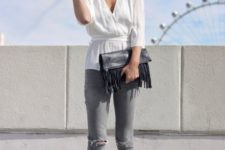 With white belted blouse, gray jeans and golden flat shoes