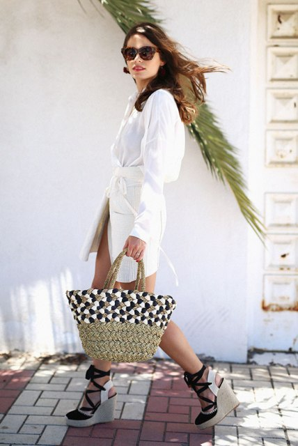 With white belted dress and printed tote bag
