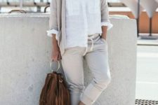 With white button down shirt, white flat shoes, brown fringe bag and gray cardigan
