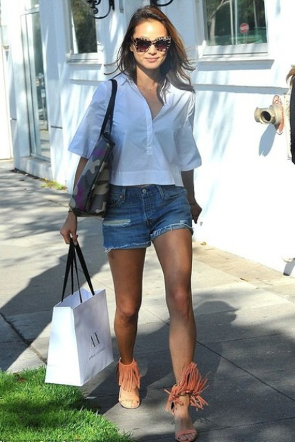 With white crop shirt, denim shorts and printed tote bag