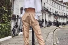 With white cropped long sleeved shirt and white sneakers