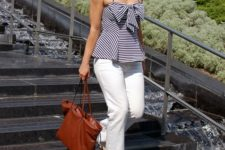 With white flare pants, beige pumps and brown tote bag