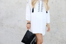 With white loose dress and black lace up flat sandals