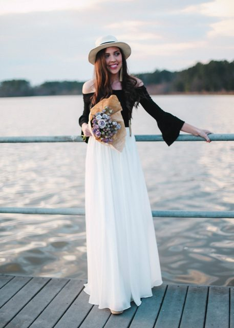 With white maxi skirt and black and white hat
