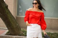 With white mini skirt, black mini clutch and brown sandals
