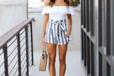 With white ruffled top, straw bag and brown shoes