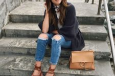 With white shirt, black loose cardigan, distressed cropped jeans and brown bag