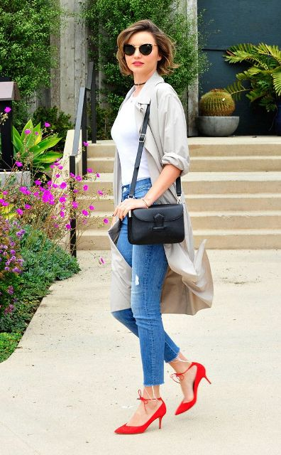 With white shirt, light gray cardigan, distressed jeans and black bag
