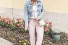 With white t-shirt, denim jacket, beige flat shoes and mini bag