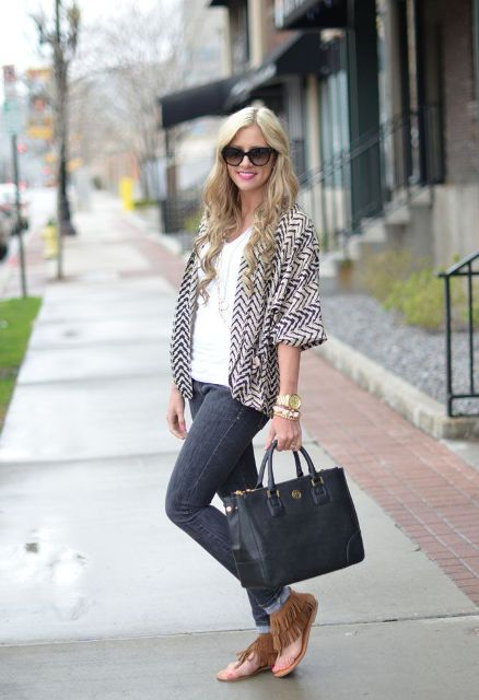 With white top, printed cardigan, skinny jeans and black tote bag