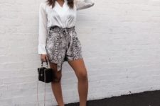 With white wrap shirt, black bag and white sneakers