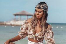 a beach party outfit with a floral ruffle off the shoulder crop top and white lace shorts plus slippers