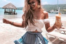 a beach party outfit with a white off the shoulder ruffle crop top and a matching blue mini skirt