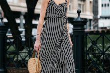 a beautiful black and white wrap ruffle midi dress on straps, black block heels, a round wicker bag for summer