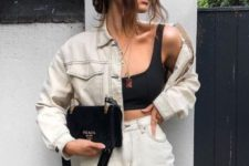 a black bra crop top, a white ripped denim skirt and a matching cropped denim jacket, a black bag