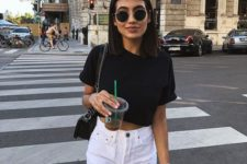 a black crop top, whiet denim ripped shorts and a black crossbody form a monochromatic look