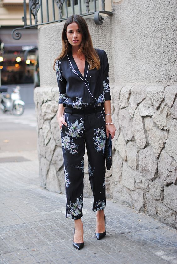 a black floral pajamas suit, bblack heels and a clutch for a lovely day to night look