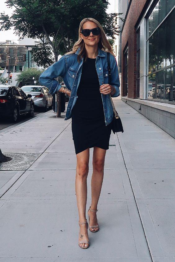 a black mini dress, a black denim jacket, nude minimalist heels and a black crossbody bag