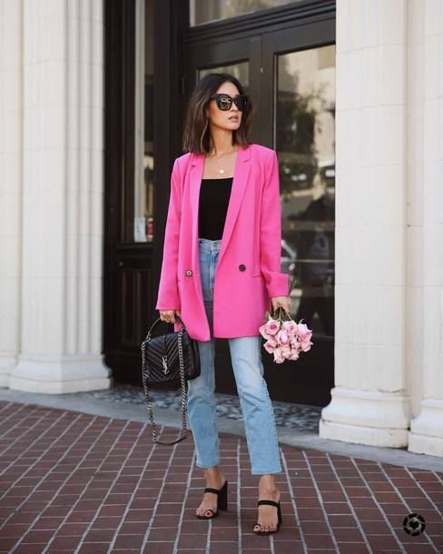 a black top, blue cropped high waisted jeans, black heels, a hot pink blazer and a black bag
