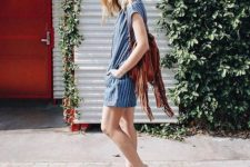 a blue and white striped mini dress with short sleeves, nude sporty sandals, a brown fringe bag