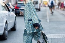 a blue printed pajamas suit with a saddle bag and trainers plus a white t-shirt