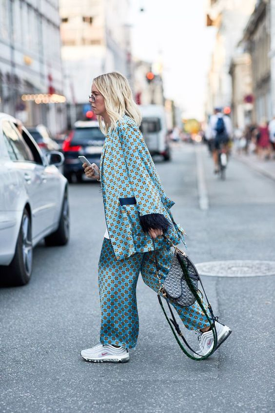 a blue printed pajamas suit with a saddle bag and trainers plus a white t shirt