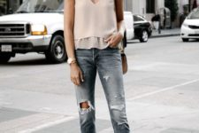 a blush top with straps, ripped cropped blue jeans, white minimalist heels and a brown bag
