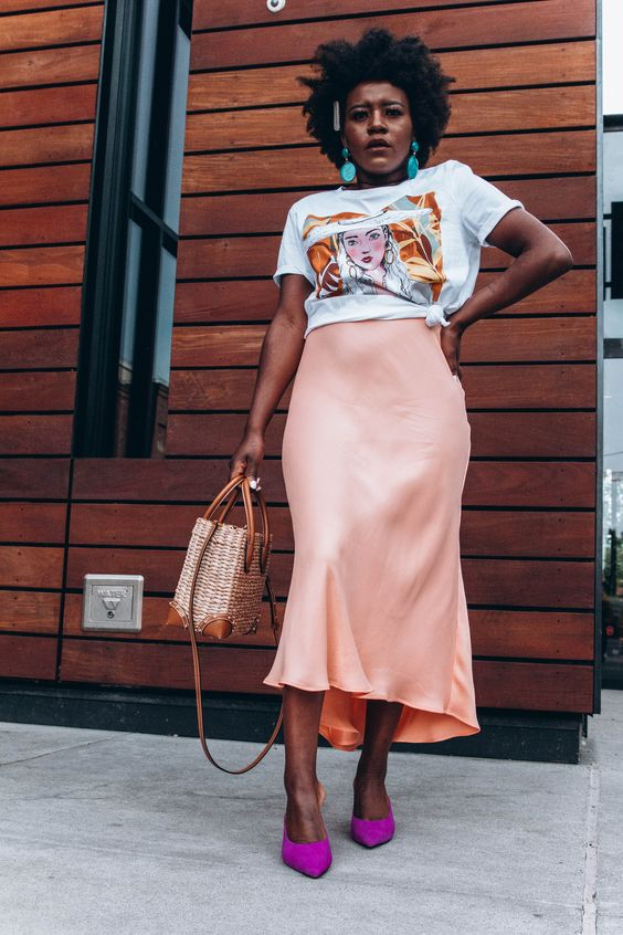 a bold summer look with a printed tee, a peachy satin midi skirt, hot pink shoes and a basket bag